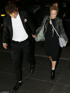 Proud spouse: Kellie Bright and her husband - Paul Stocker - walked hand-in-hand...