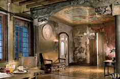 wall mural ideas ----An eagle takes flight across the foyer ceiling of actor Gerard Butler's Manhattan loft. The mural, painted by Jon De Pabon and Paul Kendall, is in tune with the space's rustic design.