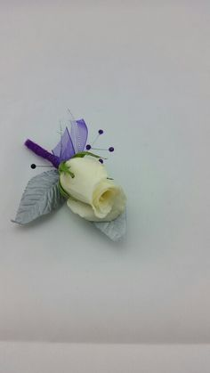 White Rose Boutonniere with Silver and Royal Purple Accent