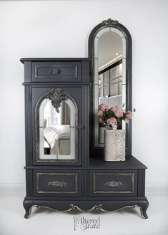 **SHIPPING IS NOT INCLUDED IN THE PURCHASE PRICE PLEASE CONTACT ME PRIOR TO PURCHASE FOR A SHIPPING QUOTE** Sophisticated dreams for a sophisticated girl…this custom armoire has been refinished in Ash grey while the details are highlighted in metallic gold and silver. This