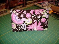 Very cute little envelope bag.  I'm not sure I'd trust it with my makeup, but it's a cute idea.  I'd love to give out scrolls in cases like this, stiffened nicely with cardboard or plastic canvas.