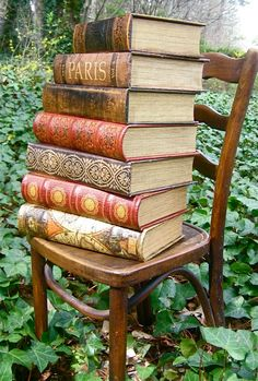 Beautiful old books, photographed so well outdoors among the ivy...
