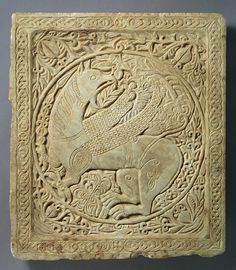 Panel with a Griffin [Byzantine; Possibly from Greece or the Balkans] - In the ancient world, the mythical beasts called griffins were symbols of royalty and protectors of the dead. They continued to play these roles for Christians. Carved griffins such as the one illustrated here are found on later Byzantine tombs, where they may have been placed to identify the dead of royal status and to afford them protection. The design of the relief is similar to patterns on Byzantine and Islamic…
