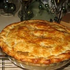 Leftover turkey and gravy inspired this savory pot pie that includes onions, mushrooms, garlic, and frozen vegetables in a savory main dish that extends the pleasures of a holiday meal.