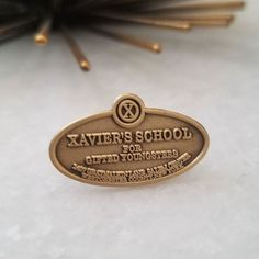 Repost @flayedman Xavier's School for Gifted Youngsters. Time to enroll! 1 inch wide. Antique gold plate. $12 shipped. #xmen #xaviersschoolforgiftedyoungsters #marvel #marvelcomics #wolverine #logan (Posted by https://bbllowwnn.com/) Tap the photo for purchase info. Follow @bbllowwnn on Instagram for the best pins & patches!
