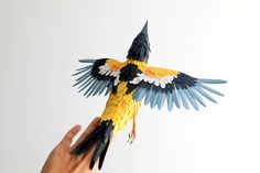 Turpial paper sculpture by Diana Beltran Herrera, via Flickr
