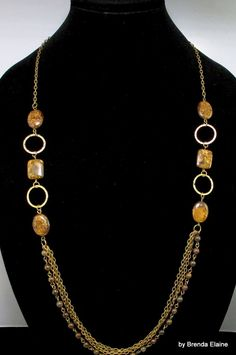 The price on this necklace has been reduced by 50%. This bold and unique necklace combines rectangular stones of bronzite and chain to create a