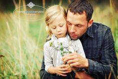 Father and daughter pose could do this blowin a dandelion or bubbles