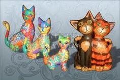 Puinen kissa tai kissapariskunta, värillä ei väliä, korkeus n. 10-15-20 cm