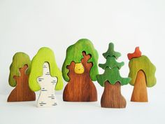 PRODUCT DESCRIPTION:  This big set includes Forest animals set (9 pcs) and tree set (5 pcs).  Forest animals: Elk, Bear, Wolf, Fox, Racoon, Reindeer, Squirrel, Hare, Hedgehog  Trees: Oak tree, Oak tree & an owl, Tree & a bird, Fir tree, Birch tree.  This set would be a great addition to any waldorf nature table or play space.  These toys will help you child to develop his imagination, to learn names of the animals, colors etc.  It is 100% handmade. Great colors, original design!  SIZE…