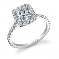 This lovely white gold engagement ring features a 1 carat cushion cut center with a total of 0.66 carats in our signature halo and diamond shank.