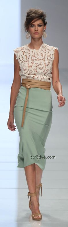 Love the high-waisted skirt, it's fit and flow, the leather wrap belt and it all works perfect with the girly top! Great silhouette.
