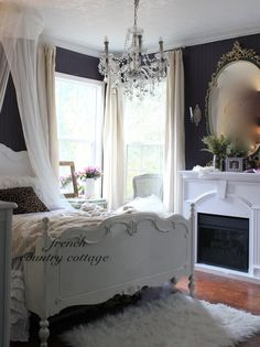 Shabby chic bedroom with dark navy walls. I like the contrast between the navy and the white.