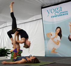 AcroYogis flying high at the Yoga Journal Conference in San Diego.