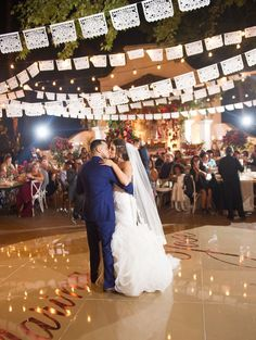 Wedding papel picado by: AyMujer! Photography: McCune Photography - http://www.mccune-photography.com Venue: Rancho Las Lomas - http://rancholaslomas.com/ Event Design: Inviting Occasion - http://www.stylemepretty.com/portfolio/invitingoccasion Read More on SMP: http://www.stylemepretty.com/california-weddings/2017/05/22/spanish-wedding-rancho-las-lomas/