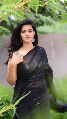 In a black color sheer saree and gold color sleeveless blouse design Beauty Full Girl, Cute Beauty, Beauty Women, Beautiful Girl Photo, Beautiful Models, Beautiful Women, Saree Hairstyles, Stylish Girl Pic, Cute Celebrities