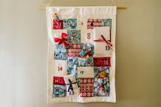 Creative Reuse: Turn Fabric Scraps Into a Homemade Advent Calendar Homemade Advent Calendars, Advent Calendars For Kids, Fabric Advent Calendar, Diy Calendar, Quilted Placemat Patterns, Advent For Kids, Christmas Calendar, Christmas Signs Wood, Diy Network