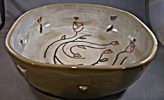 Celticly inspired with Irish and Scottish tradition in mind this bowl is meant as more than just a display piece. Beautifully octaganolly shaped both on the wheel and later by hand, this bowl is also hand drawn, carved and painted.  It is finished with a food safe glaze so it is safe to