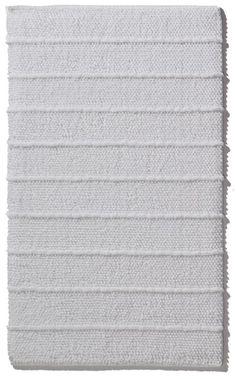 Moderner weißer beiseitig verwendbarer Badteppich aus 100% Baumwolle, handgewebt, gekämmt und ringgesponnen. Gesehen für € 24,95 bei kloundco.de.