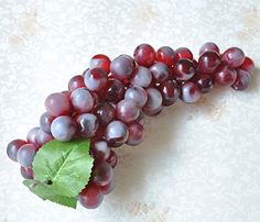 Size:about 25cm/ 9.84 inches length. Lifelike artificial grapes cluster,high quality. With a hole design allows to easy attach to hang the bunches as a garland or to create a vine effect. Suitable for home,garden,kitchen decorative,holiday festive use ,tabletop display etc. Package included: 1x bunch grapes cluster (Purple ).