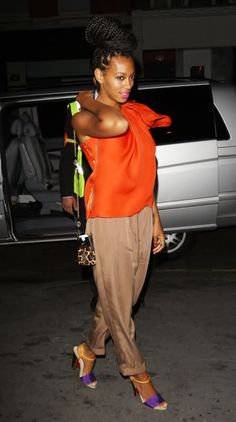 Add a bright pop of color with neon shoes. Solange Knowles is wearing colorblock sandals by Fendi.