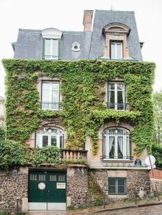 Ivy covered house in Paris. Photo by Think Foto.