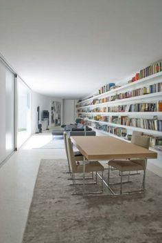 ..Love the length of the bookcase/book shelves, but not the decor.