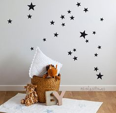Fun idea...black stars on your baby's ceiling or above their crib! #blackandwhite #pishposhbaby #walldecal