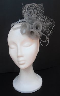 Grey fascinator headpiece .