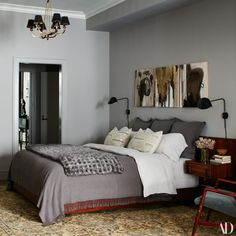 The master bedroom features Tim Furzer paintings, plus a bed dressed in Matteo linens and an Adrienne Landau crocheted-mink throw. Bedding Sets Online, Luxury Bedding Sets, Modern Bedding, Comforter Sets, Neutral Bed Linen, Pottery Barn Teen Bedding, Toddler Girl Bedding Sets, How To Dress A Bed, Bed Linen Design