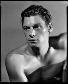 Johnny Weissmuller, a negative from a publicity shot,1932.  Born Peter Johann Weissmüller (1904 – 1984) he was an American competition swimmer and actor best known for playing Tarzan in films of the 1930s and 1940s and for having one of the best competitive swimming records of the 20th century.