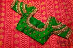 Gorgeous pink saree with green designer blouse with kundan work allover the blouse with matching pink highlights. Blouse has elbow length sleeves with layered chain design work on it. 03 December 2017