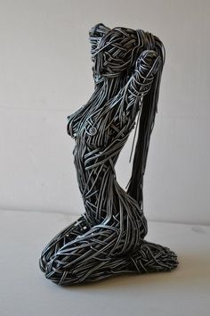 English artist Richard Stainthorp captures the beautiful energy and fluidity of the human body using wire. The life-sized sculptures feature both figures in motion and at rest, expressed in the form of large-gauged strands that are densely wrapped around and through one another. By doing this, he gives the work an undeniable presence