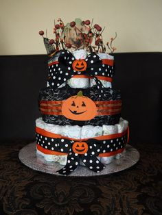 beautifully handcrafted 3tiered diaper cake for a halloween themed baby shower to give