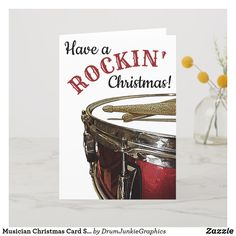 Wish your friends and family a Rockin' Christmas with this drummer holiday card featuring a beautiful red snare drum and drum sticks. #drummerchristmas #snaredrum #drumsticks #drumjunkie
