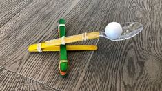 Have fun launching balls in the air and see how far you can fling them with this popsicle stick catapult! Using materials you already have at home, you can bulid this catapult with your kids and have hours of fun! Popsicle Stick Catapult, Popsicle Stick Crafts, Popsicle Sticks, Craft Stick Crafts, Craft Sticks, Fun Activities For Kids, Science For Kids, Crafts For Girls, Diy For Kids