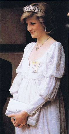 Memories Of Diana : Attending Banquet At The Royal Society Of Arts; May 14th 1984. Princess Diana was pictured arriving for a banquet at the Royal Society Of Arts, in Piccadilly in London. The event came during her pregnancy with Prince Harry, and she wore a glamorous white evening gown embroidered with silver threads.
