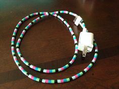 Perler beaded iPhone charger I made using the Perler bead headphones instructions (also pinned on this board)