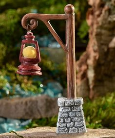 Take a look at this Glow-in-the-Dark Twig Lamppost Figurine today!