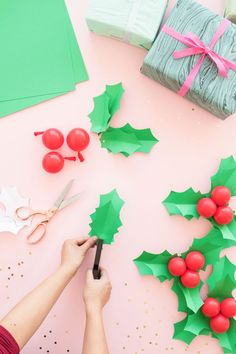 Holly Balloon Gift Toppers | Oh Happy Day! Taking inspiration from our holly balloon sticks project from last year, we came up with these miniaturized versions that can be used as striking gift toppers for your holiday presents! #diy #christmasgifts #holiday #crafts #christmas