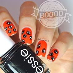 October Nail Art Challenge- Critters  I love the little googly eyes! ☺️ I used essie's 'orange its obvious,' 'licorice,' and 'blanc'.