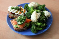 Toasted whole grain bread with horseradish, avocado, smoked salmon, cucumber and parsley; cream cheese, mustard, dried tomatoes, parsley and egg; cauliflower and broccoli