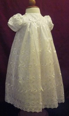 Allover eyelet lace christening gown = memories of the christening robe that my two children wore - it was worn by their great grandmother (who lived to over 100 years old)