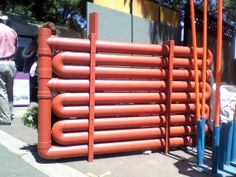 pvc pipe water tank, perfect for a narrow space in an urban backyard -- no good link to the company that thought it up, but DIY as rain barrel from PVC would be possible.