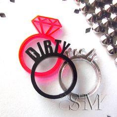 Beautiful, Dirty Rich - layered laser cut acrylic rings. $15.00, via Etsy.