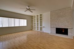 This spacious, mid-century modern condo has all the right stuff. Huge public room that includes a signature, rough cut marble fireplace...