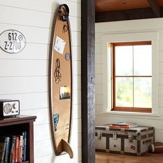 Surfboard Corkboard is a great place to put souvenirs from trips or artwork. Place it to the right of the window. #potterybarnteen