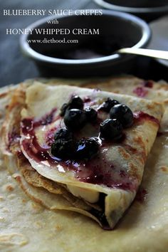 Blueberry Sauce Crepes with Honey Whipped Cream: Soft and silky Crepes filled with a sweet Honey Whipped Cream and accompanied by a warm Blueberry Sauce.
