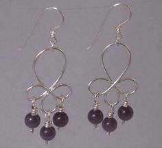 """#558 Purple Cat's Eye Earrings   Three purple cat's eye beads dangle from each of these handcrafted sterling silver earrings.  *Measure approximately 56mm x 22mm (2 5/16"""" x 7/8"""").  *By StoneChamber  http://www.supercutefashions.com/catalog.php?item=51"""