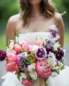 This New York bride carried bouquet of creamy white garden roses, vibrant coral charm peonies, deep purple cosmos, peach ranunculus, white andromeda, white clematis, and maidenhair fern from Poppies and Posies. The clutch was tied with a dusty-rose raw silk ribbon.